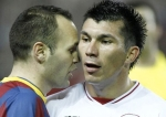 Iniesta tries to initimidate Medel